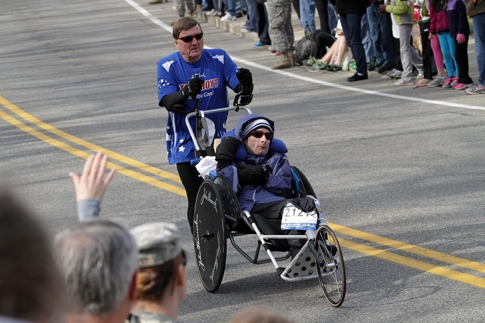 (041513 Hopkinton, MA) Dick Hoyt and his son Rick Hoyt run during the 117th Boston Marathon in Hopkinton, Mass., Monday, April 15, 2013. Photo by Chitose Suzuki