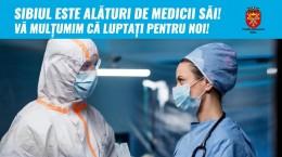 medici coronavirus panou outdoor Primăria Sibiu