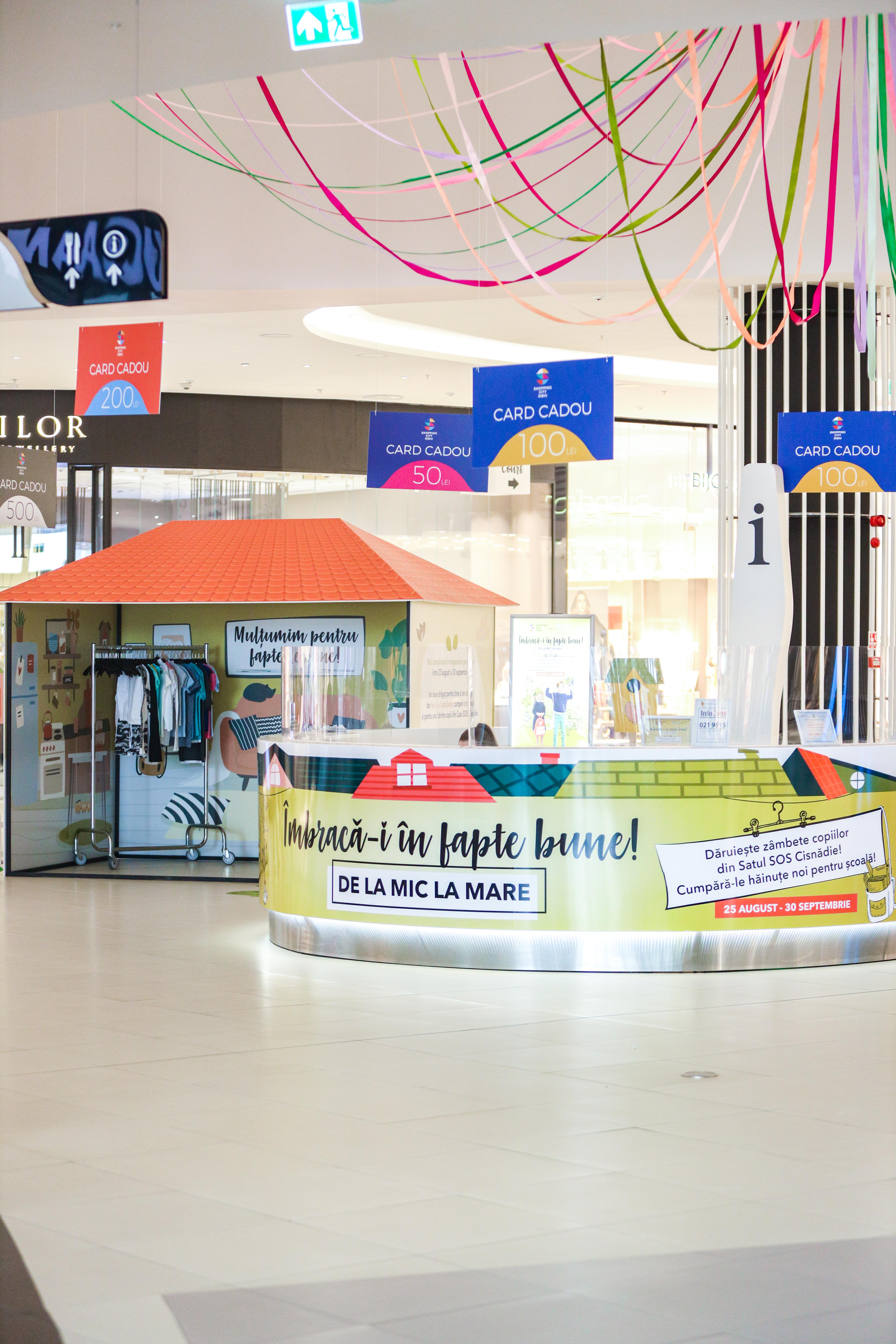 """SOS Satele Copiilor este partener de bine al Shopping City Sibiu în campania """"Îmbracă-i în fapte bune"""""""